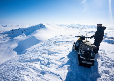 Snowmobiling while hunting in Magadan, Russia with Kulu Safaris