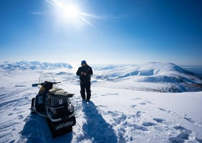 Snowmobiling in the snowy hills of Magadan, Russia with Kulu Safaris