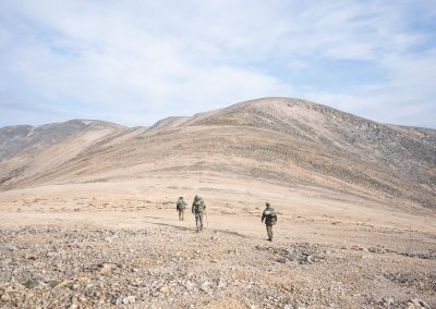 Hunters and guides hiking on the mountains with Kulu Safaris