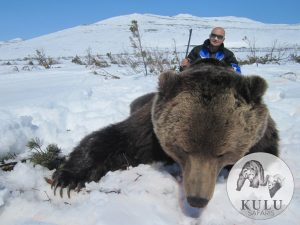 Hunter with a giant brown bear trophy