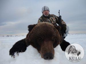 Hunter with his brown bear trophy, taken with Kulu Safaris