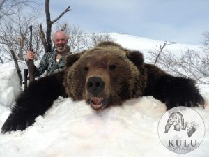 Hunter and the trophy, Kulu Safaris, Magadan, Russia