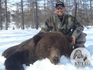 Hunter and his brown bear trophy