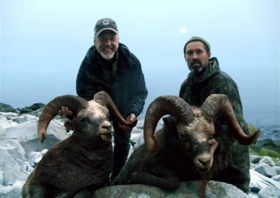 Hunters and their show sheep trophies in twilight, Magadan, Russia with Kulu Safaris
