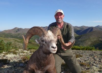 Todd Fry hunting snow sheep in the mountains of Magadan, Russia with Kulu Safaris